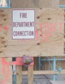 Temporary standpipe with FDC Sign